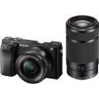 Sony Alpha A6100 + 16-50mm f/3.5-5.6 OSS + 55-210mm f/4.5-6.3 OSS